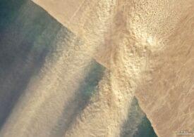 NASA a făcut publice imagini spectaculoase cu o furtună de nisip din Namibia, trecând peste ocean (Galerie foto)