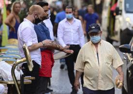 Masca poate deveni obligatorie în Paris! Deja se cere pe Champs-Elysées, iar adunările cu peste 10 persoane sunt interzise, unde nu e destul loc