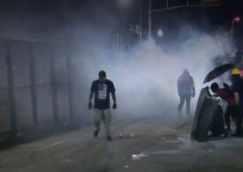 Proteste violente după ce alt american de culoare a fost împușcat de poliție: Două persoane au fost ucise