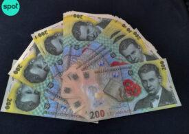 Atenție la bancnotele de 200 de lei! Niște infractori le falsificau și le răspândeau prin țară