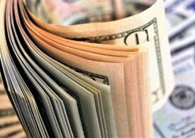 Dolarul coboară la minimul ultimilor trei ani după ce democrații au preluat controlul Senatului american