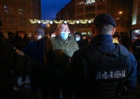 Huiduieli pentru AUR la Timișoara: Aprind lumânări pentru victimele Revoluției, dar au torționari comuniști în partid