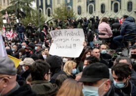 Proteste în Georgia: Zeci de persoane au fost lovite și reținute de poliție